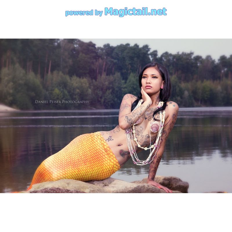 Mermaid beauty at a lake